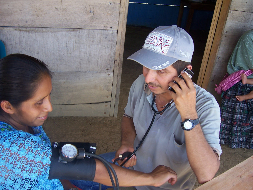 Healthcare worker treating patient in a remote location in Guatemala.
